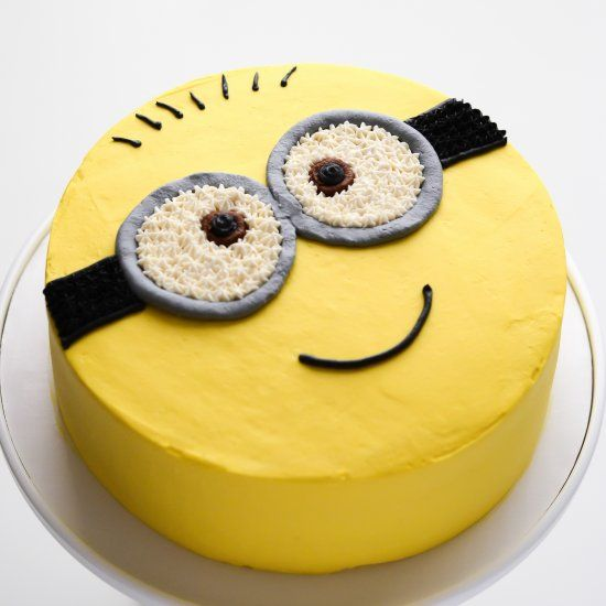 Minion cake - chiffon cake filled with freshly whipped cream and fruit cocktail, and decorated with colored whipped cream