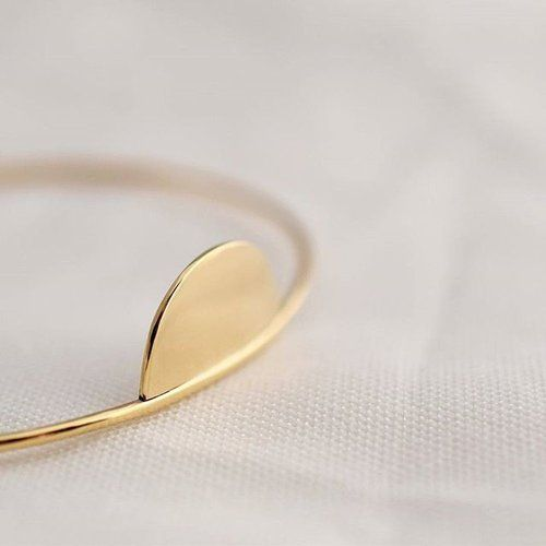 The Half Moon Bangle from our Sora Collection is solid 9ct gold for a subtle glow that won't wane.  #ISLEjewellery #beautyinsimplicity #handmade #goldsmithing #modernjeweller #finejewellery #finejewelry #9k #9ct #gold #bangle #traditional #modern #lessismore #sisters #tokyo #ireland #irishdesign #yellowgold #sora #空 #geometric #halfmoon #nightsky #