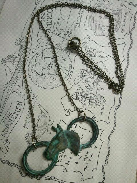 """Incredible verdigris brass necklace with horse head and shoes. Comes with 20"""" brass necklace"""