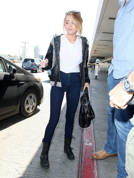 Miley Cyrus Photo - Recently Engaged Miley Cyrus Shows Off Her Ring At LAX