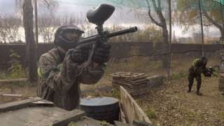 Image copyright                  Jack Garland                                                     In a bit of woodland on the outskirts of Moscow, several dozen students are running around in combat fatigues, shooting one another with soft air-gun pellets. The weekend paintballing trip has been organised by an opposition party. It all looks harmless enough. But