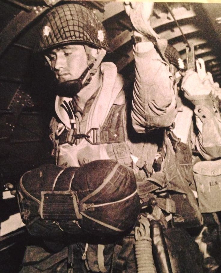 Paratrooper Don Ross, HQ 3/506th PIR, 101st Airborne Division. The photo was taken on june 4, 1944 (note lack of faces being blackened), by the Signal Corps and was staged for them.