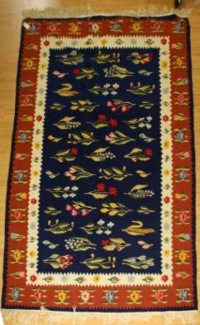 $40 SEMI-ANTIQUE 6 X 9 ROMANIAN KILIM RUG    Sign In to see what this sold for  Floral design in bright colors. Blue field with red border. Warp strand tassels are tied in bundles. Rug is in excellent condition and appears to have never been used. 6x9