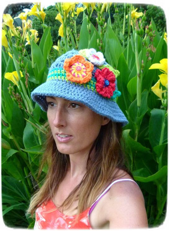 100% cotton women's sun hat in denim blue with 3 bright multi-coloured flowers, leaves & accent stripes. Handmade in Aotearoa NZ. www.facebook.com/thelittlebeenz www.etsy.com/shop/thelittlebeenz