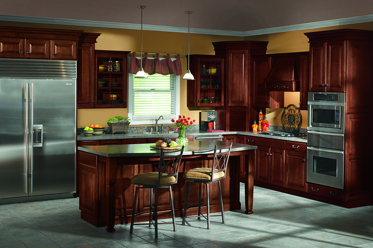 A Beautiful Dark Kitchen Featuring Wolf Signature Cabinets In Lorain Door  Style In Maple With A