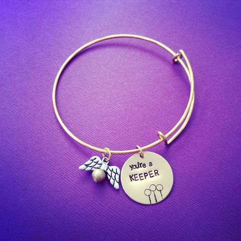 You're A Keeper Quidditch Golden Snitch Adjustable Bangle Bracelet Handmade Harry Potter Inspired  A handmade and hand stamped bracelet, with  you're a keeper written across the 7/8 disc, a golden snitch charm. This bangle is adjustable, similar to Alex & Ani style bracelets. Would make a neat gift