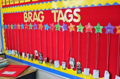 """No more treasure box! She uses """"Brag Tags,"""" which are like necklaces that she adds to as students earn each tag."""