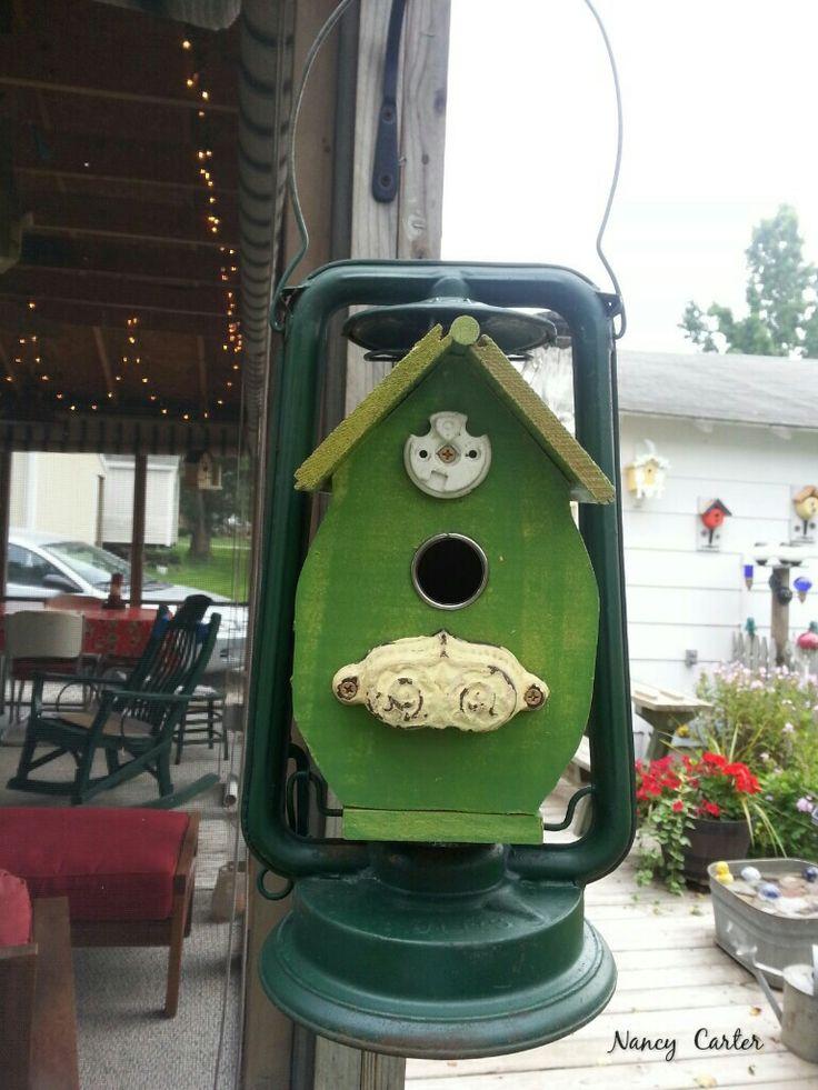 My birdhouse that I built inside an old antique lantern.