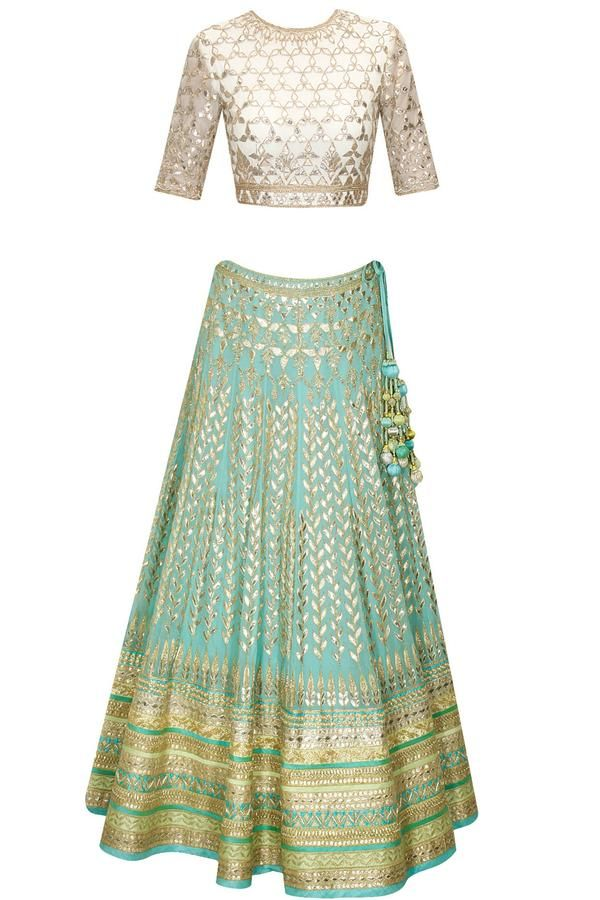 Featuring an elaborate powder blue chiffon lehenga embellished with traditional gota patti embroidery.  It is paired with white gota patti embroidered choli in net with cut-out detailing at back.  It also comes along with powder blue net dupatta with gota applique work on it.  -www.cooliyo.com