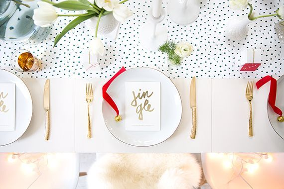 """Cards at each place setting read """"jingle jingle mix and mingle, grab some treats and take your seat."""""""