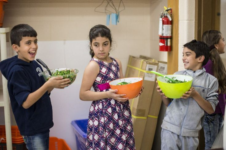 Abdel Rahman Obeid, Malak AlNajar and Kusai Alzoubi hold finished bowls of tabbouleh they prepared as part of a summer camp called S.A.I.L. (Summer Adventure In Learning) at Thornwood Public School in Mississauga.