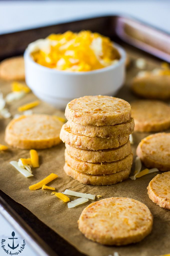 These Cheddar Cheese Coins are cheesy, buttery, zesty bites that are steps above storebought crackers! They're perfect for your fall cheese board!