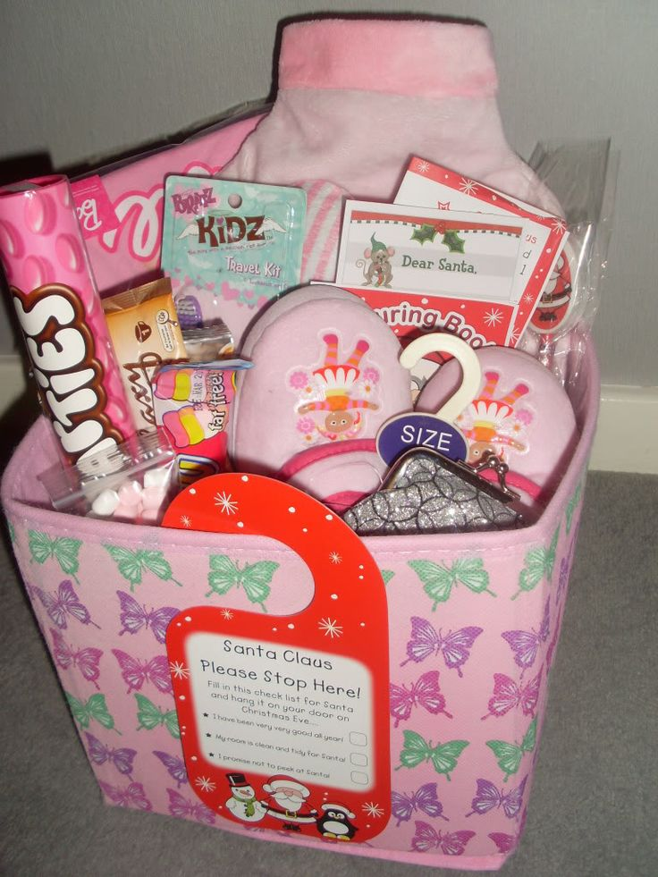 Christmas eve hamper To include: dvd, slippers, pjs, snowman soup, mug, book etc.