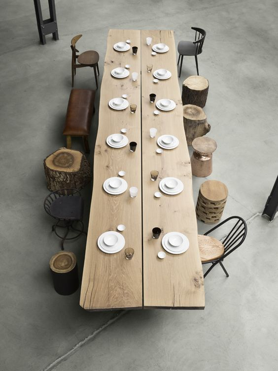I love the mixture of tree stumps and chairs coupled with the length of a formal hand hewn dining table....brilliant.