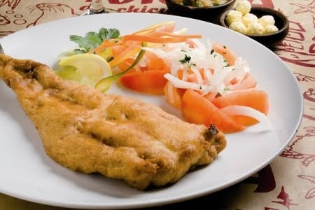 Pescado Frito con Ensalada a la Chilena...(The fried fish is also served with rice, mashed potatoes, Chilean salad or fries)