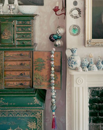 Min's bedroom is home to an 18th-century green and gold lacquer desk with a rope of silk-covered oriental worry beads draped over its doors