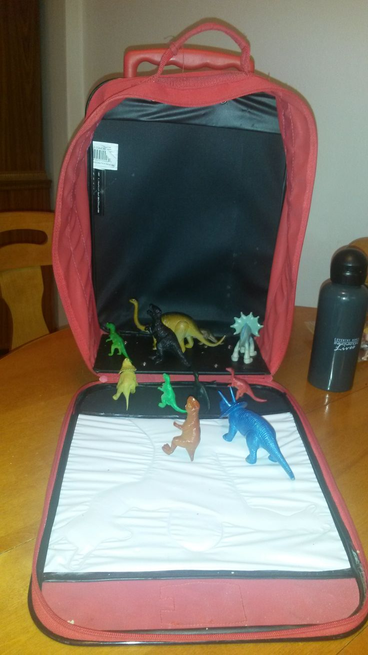 November 10, 2014: The dinos try to figure out what is so special about the suitcase my son drags around with him around the house every day.