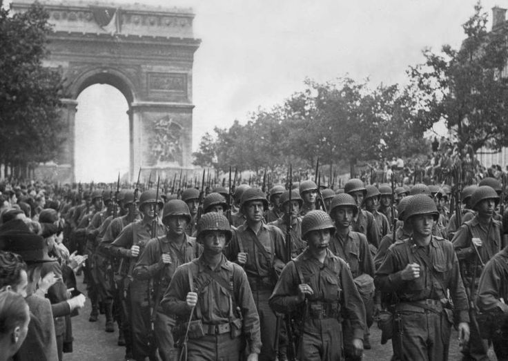 Aug 25, 1944 liberation of Paris with American troops marching down the champs-elysee via the arc de triomphe