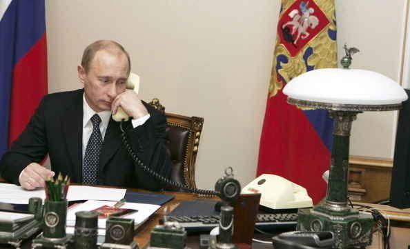 Receptionist Putin: 15 photos that prove Vladimir Putin is actually Career Barbie.