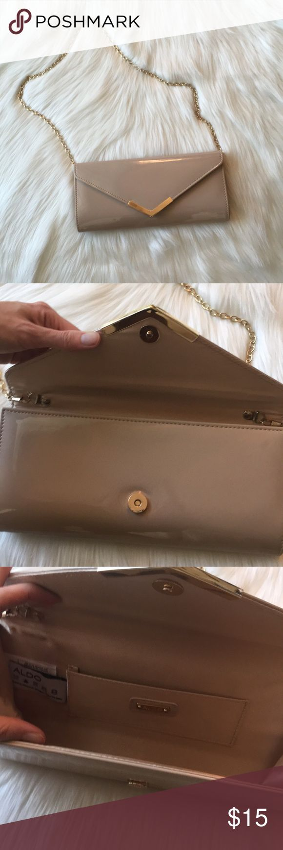 """Aldo Gold and Neutral Clutch w Chain Elegant and versatile clutch from Aldo in EUC! Gold hardware on front magnetic snap closure and gold chain that can be worn over the shoulder or tucked into the purse to convert to a clutch. 11"""" long, 5.5"""" tall, 1.5"""" wide, 16"""" strap drop. See tag photo for material content. Aldo Bags Clutches & Wristlets"""