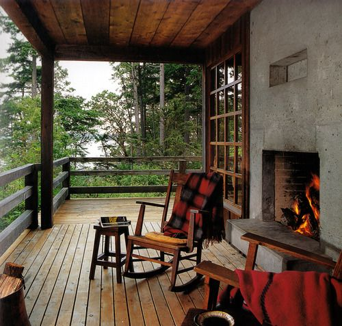 Mountain house porch with fireplace.