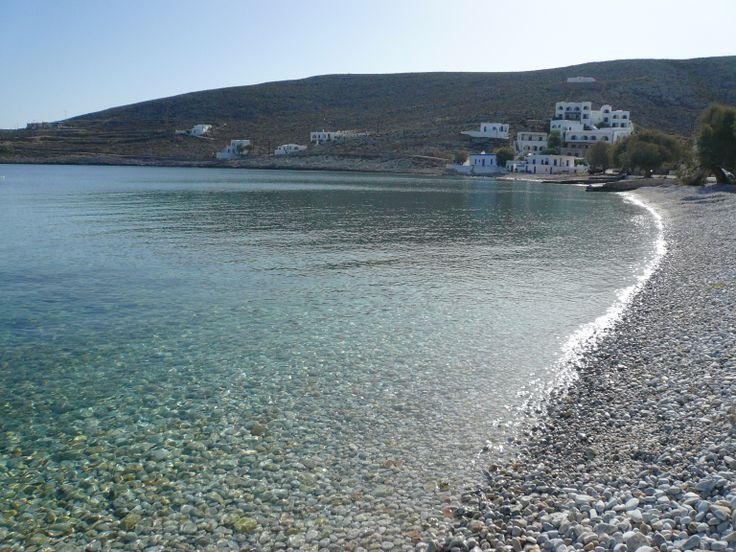 Karavostassi peble beach in front of Vrahos Boutique Hotel.