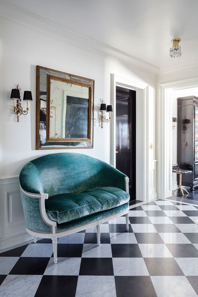 An 1800s velvet settee greets visitors in the foyer of this Upper East Side home, designed by Jennifer Vaughn Miller. | Lonny.com