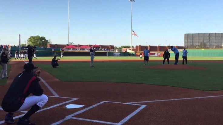 Karl Towns, Dakari Johnson and Trey Lyles throw out the first pitch at t...