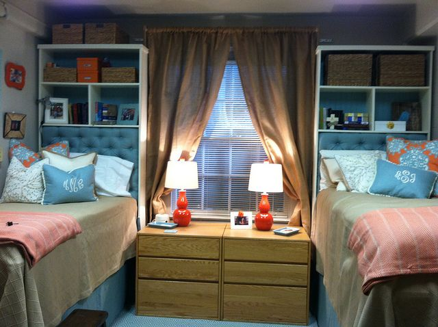 Dorm room.  Really like the bookcases as headboards.  Looks nice and extra storage.