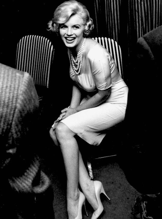 Marilyn at a press conference, photographed by Manfred Kreiner in March 1959.