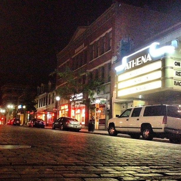 A night shot of the Athena Cinema on Court Street.