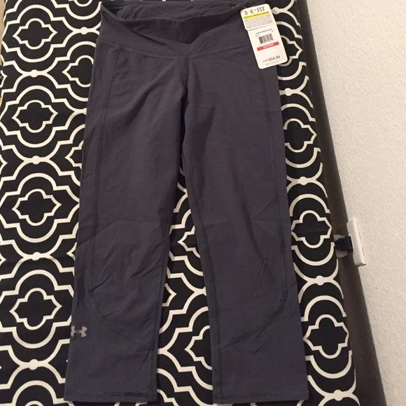 NWT. Gray Under Armour heat gear capris NWT. Under Armour. Heat gear. Size XS. Gray. Really cool lightweight material. Stretchy fabric. Zippered pocket on back. No flaws. Under Armour Pants