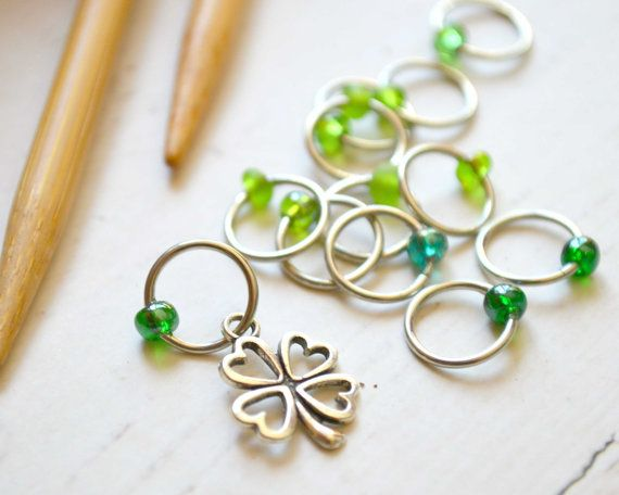 Symbol of Luck / Knitting Stitch Marker Set X-Small, Small, Medium, Large Sizes Available in sets of 8, 12, 16 or 20  This set features a four leaf clover charm on silver rings with an assortment of frosted and semi-transparent seed beads in varying shades of green. A clover leaf with four leaflets, rather than the typical three, is thought to bring good luck. May it travel with you always and forever. DETAILS: + Handcrafted with sturdy but lightweight 18 gauge wire and glass seed beads…