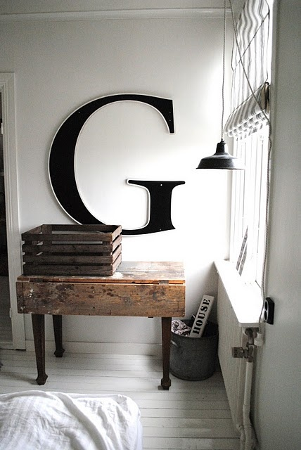 Here again scale is key. Note the G is not floating on a large wall (which would be the natural instinct) No.  It's framed by a much smaller wall that without the letter, would be doing nothing.  Instead the graphic pulls the eye into the space.  Also note the primitive elements build up to it and over lap it slightly to ground the entire tableaux. The intentional thought is extreme yet not forced.