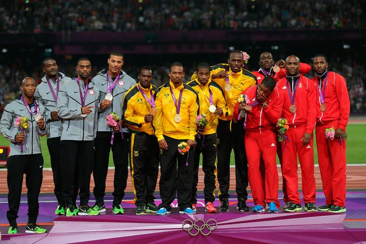 London 2012 - Jamaican athletes wear gold in the podium presentation for the men's 4x100m relay with USA in silver, Trinidad and Tobago in bronze on August 11, 2012.  2012 Getty Images