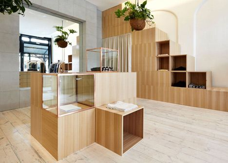 Kloke Shop Interior Functions Copper Clothes Rails And Wooden Display Units By Sibling | Architect Lover