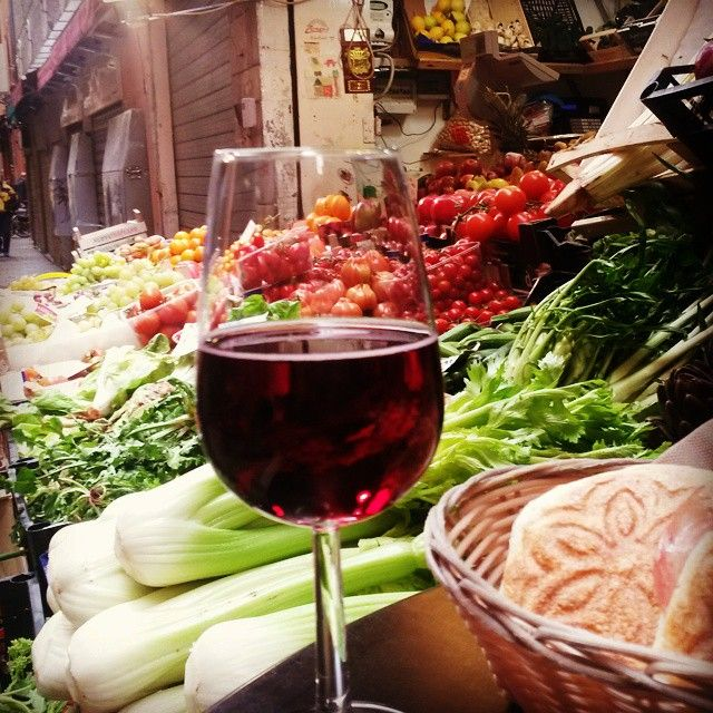 "Labrusco‬ & ‪Tigelle‬ among the bright colors of ‪#‎Bologna‬'s ancient ‪#‎market‬ ""Quadrilatero"" - Instagram by st.rvk"