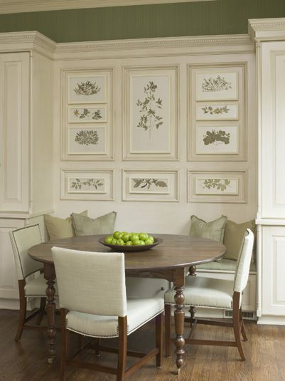 Wow. The soft colors, the banquette seating, the table legs, the chair nailheads, and the prints inside moulding - all great details.