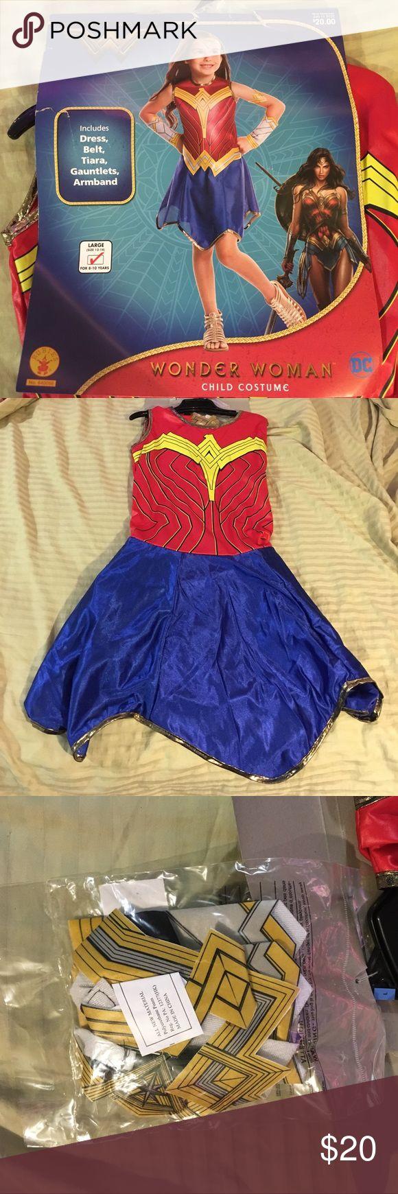 Kids Wonder Woman costume Includes: dress, belt, tiara, gauntlets, armband. Size Large (size 12-14) for 8-10 year olds. Rubies costume #640066 DC Comics Costumes Superhero