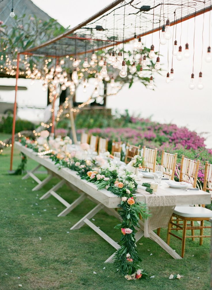 Romantic Cliff-top Wedding by the Sea in Bali #tablescapes, #garland. Photography: Jemma Keech - jemmakeech.com