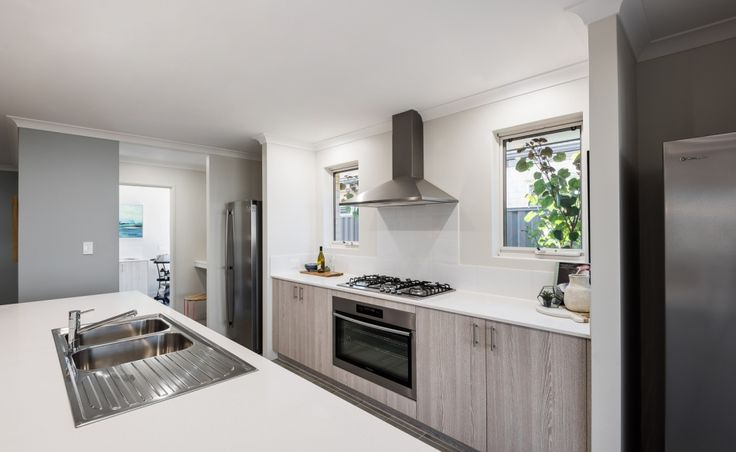 The kitchen features Caesarstone benchtops and 900mm Westinghouse appliances