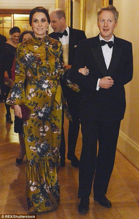 Resplendent in saffron yellow, The Duchess of Cambridge was escorted into the dinner by th...