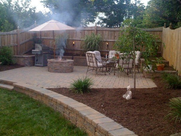 Backyard i like the step downs for a garden idea maybe for Cool outdoor patio ideas