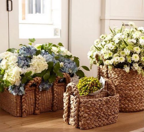 I love the look of the hydrangea one- about this size for the two end of the aisle arrangements, could be in wooden boxes though