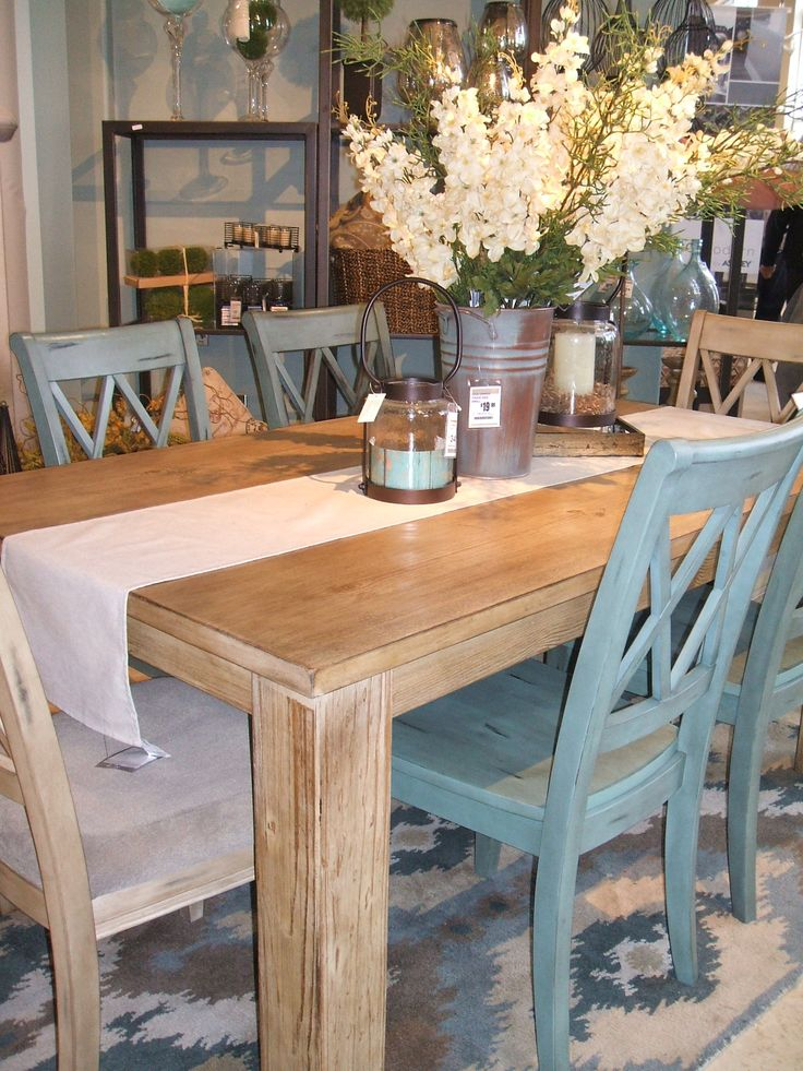Love the table dressing with the mix of chairs.... Cool, shabby farmhouse.
