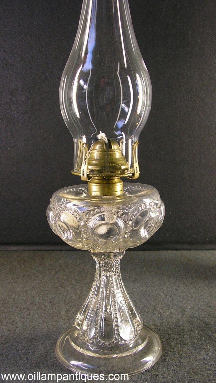 The pattern of this lovely little antique oil lamp is early American patterned glass or EAPG Bullseye with Diamond Point. The clear glass lamp was made by Dalzell, Gilmore & Leighton Co. of Findlay, Ohio circa 1892