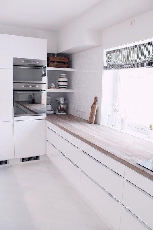 white modern kitchen cabinets, hidden open corner storage