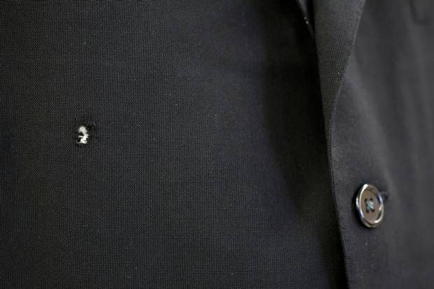 Bullet holes - including one around the front right chest - still draw the eye on Gov. John Connally's three-button black wool Oxford Clothes suit, though no bloodstains remain. Nellie Connally, who was at his side in the motorcade that day, had her husband's suit cleaned before presenting it to the state archives. It's the first public display of the clothing since Nov. 22, 1963