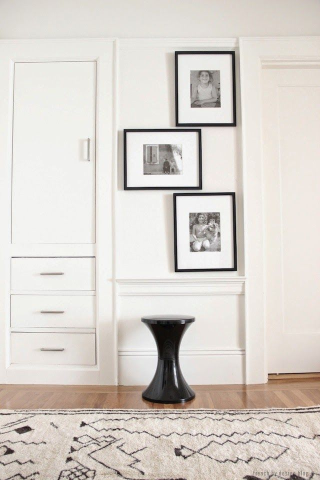 Upstairs white in hallway wooden floor family pictures in frames