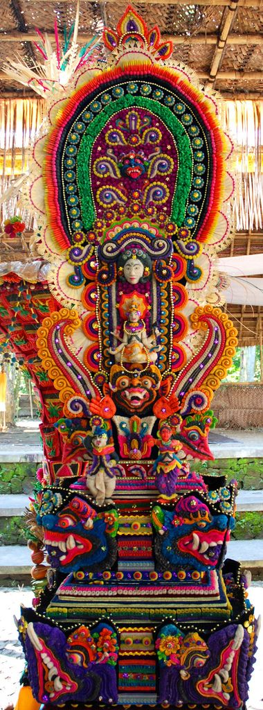 A Pillar for the Gods by Caneles on Flickr - This is a altar in offering to the Gods in the Hindustani temple in the monkey forest in Ubud, Bali. Big parts of the pillar are made from food, fat and flowers.